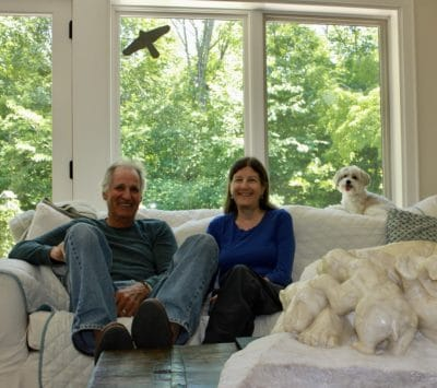 Dale and Loti share their living room with animals--their dog Gibbs, a sculpture of polar bears, and a sticker warning birds not to fly into the glass.