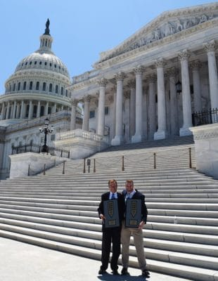 Shrimper Khare and Peter Barr accept the trail achievement award on Capitol Hill.