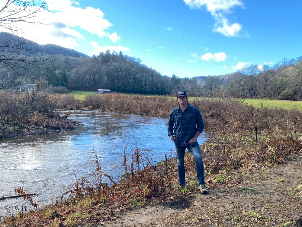 Woody Platt stands by the restored section of the East Fork.